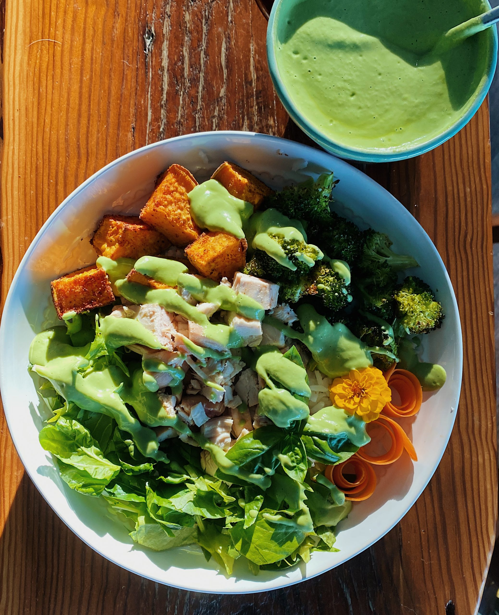 roasted veggie nourish bowl with a green goddess dressing